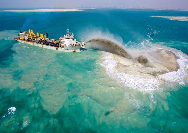 Zand storten voor privé eiland